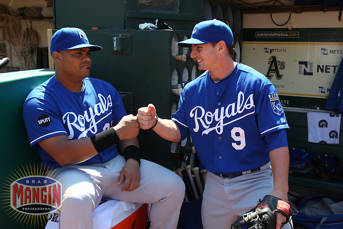 OAKLAND, CA - SEPTEMBER 5: Brayan Pena #27 and Johnny Giavotella #9 of the Kansas City Royals get ready in the dugout before the game against the Oakland Athletics at O.co Coliseum on September 5, 2011 in Oakland, California. Photo by Brad Mangin