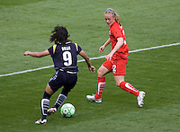 Washington Freedom's Becky Sauerbrunn and LA Sol's Han Duan. The LA Sol defeated the Washington Freedom 2-0 in the opening game of Womens Professional Soccer at Home Depot Center stadium on Sunday March 29, 2009.  .Photo by Michael Janosz