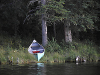 Canoe moored on the shores of Fish Lake, Alberta. This pristine setting offers some spectacular scenery.