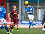 St Johnstone v Motherwell…20.02.16   SPFL   McDiarmid Park, Perth<br />Simon Lappin heads clear from Louis Laing<br />Picture by Graeme Hart.<br />Copyright Perthshire Picture Agency<br />Tel: 01738 623350  Mobile: 07990 594431