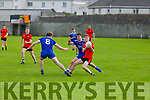 Tarberts Finbarr Carrig tries to get past Joe Hoare and  Eamonn Hickson of Annascaul in the Junior Club Football Championship semi final.