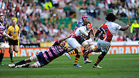 Ben Morgan of Gloucester Rugby hangs onto Elliot Daly of London Wasps during the Aviva Premiership match between London Wasps and Gloucester Rugby at Twickenham Stadium on Saturday 19th April 2014 (Photo by Rob Munro)