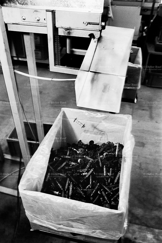"""France. Saône-et-Loire department. Chalon-sur-Saône. Kodak factory. Camera recycling. The """"ready to take pictures"""" camera is a small camera commonly described as disposable but in fact assembled for customers to return it after use. After being dismantled, verified and meticulously cleaned, some pieces are reused, other recycled (86%). The plastics parts are torn, melted, recasted and then reassembled. Eastman Kodak Company. Chalon-sur-Saône is located in the south of the Burgundy region. © 1996 Didier Ruef .."""