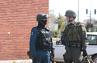 2003 File Photo<br /> <br /> a SWAT Piliceman (L) talk with a Provincial Poliman (Surete du Quebec) (R)  after an hostage crisis near  Montreal, CANADA.<br /> <br /> <br /> (Mandatory Credit: Photo by Sevy - Images Distribution (©) Copyright 2003 by Sevy<br /> <br /> NOTE :  D-1 H original JPEG, saved as Adobe 1998 RGB.