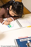 Education preschoool children ages 3-5 art activity girl drawing picture of the planet earth vertical