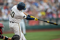Michigan Wolverines third baseman Blake Nelson (10) swings the bat during Game 1 of the NCAA College World Series against the Texas Tech Red Raiders on June 15, 2019 at TD Ameritrade Park in Omaha, Nebraska. Michigan defeated Texas Tech 5-3. (Andrew Woolley/Four Seam Images)