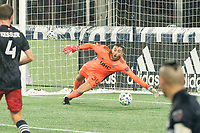 FOXBOROUGH, MA - NOVEMBER 1: Matt Turner #30 of New England Revolution leaps at a shot on goal during a game between D.C. United and New England Revolution at Gillette Stadium on November 1, 2020 in Foxborough, Massachusetts.