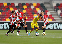 6th September 2020; Brentford Community Stadium, London, England; English Football League Cup, Carabao Cup, Football, Brentford FC versus Wycombe Wanderers; Matthew Bloomfield of Wycombe Wanderers challenged by Emiliano Marcondes and Jan Zamburek of Brentford