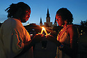 Chris Williams, born and raised in New Orleans, and his new friend Danielle Miles, a volunteer who moved to the city after the hurricane, light their candles at a vigil in Jackson Square marking the second anniversary of Hurricane Katrina, 2007.