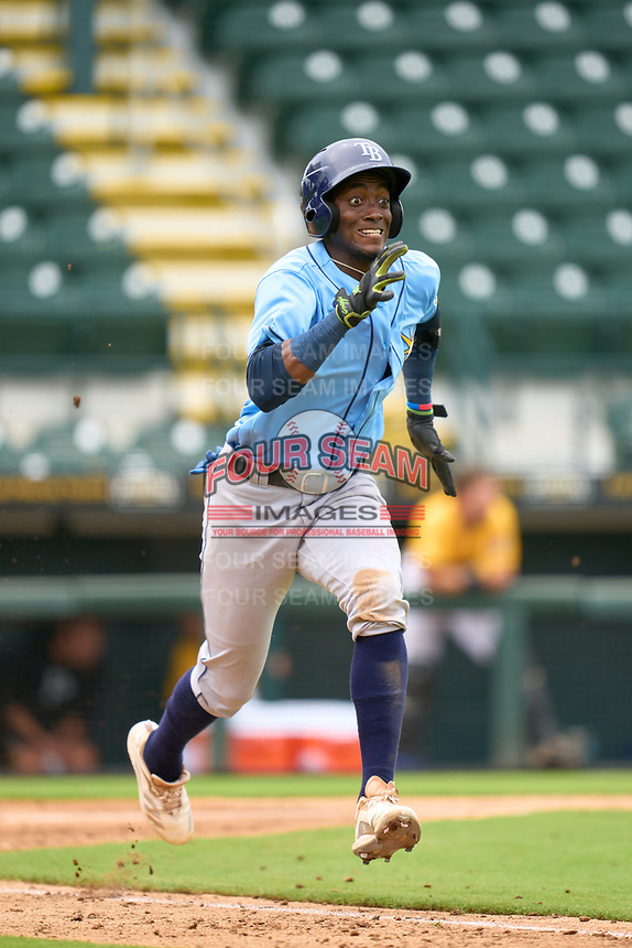 FCL Rays Alejandro Pie (64) runs to first base during a game against the FCL Pirates Gold on July 26, 2021 at LECOM Park in Bradenton, Florida. (Mike Janes/Four Seam Images)