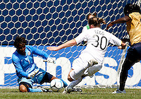 U.S. goalkeeper Briana Scurry (1) saves a breakaway by New Zealand forward Rebecca Tegg (30).  U.S. defender Tina Ellertson (8) trails the play.  The U.S. Women's National Team defeated New Zealand 6-1 at Soldier Field in Chicago, IL on August 12, 2007.