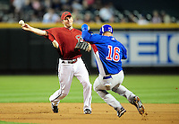 Apr. 2, 2010; Phoenix, AZ, USA; Arizona Diamondbacks shortstop Stephen Drew throws to first to complete a double play against the Chicago Cubs at Chase Field. Mandatory Credit: Mark J. Rebilas-