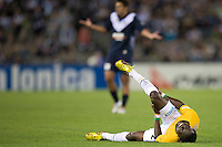 MELBOURNE, AUSTRALIA - NOVEMBER 06: Adama Traore of Gold Coast United grimaces in pain during the round 13 A-League match between the Melbourne Victory and Gold Coast United at Etihad Stadium on November 6, 2010 in Melbourne, Australia (Photo by Sydney Low / Asterisk Images)