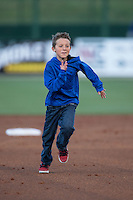 A young fan runs the bases between innings of the South Atlantic League game between the Hickory Crawdads and the Kannapolis Intimidators at Kannapolis Intimidators Stadium on April 8, 2016 in Kannapolis, North Carolina.  The Crawdads defeated the Intimidators 8-2.  (Brian Westerholt/Four Seam Images)
