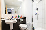 """© Joel Goodman - 07973 332324 - all rights reserved . 12/01/2020 . Salford , UK . En suite bathroom attached to the master bedroom of the rented flat of Kayne Lewis (25) , which he shares with Chase (the 5 month old Chihuahua) and some fish , in apartment block """"Duet"""" , on Salford Quays in Greater Manchester . Photo credit : Joel Goodman"""