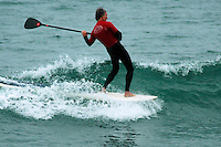 Saturday, June 14, 2008, Tourmaline Surf Park, Pacific Beach, San Diego, CA, USA.  Whitney Guild competes in the Stand-Up Paddle competition during the Pacific Beach Surf Club's Tenth Annual Longboard Classic at Tourmaline Surfing Park.  The event was well attended despite gray, June gloom clouds and fickle, windy surf conditions.