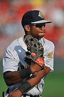 Left fielder Kendall Coleman (12) of the Charleston RiverDogs warms up before a game against the Greenville Drive on Tuesday May 17, 2016, at Fluor Field at the West End in Greenville, South Carolina. Greenville won, 4-2. (Tom Priddy/Four Seam Images)