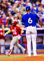 26 March 2018: Toronto Blue Jays pitcher Marcus Stroman stands on the mound as St. Louis Cardinals outfielder Marcell Ozuna rounds the bases after hitting a solo home run in the 5th inning of a pre-season game at Olympic Stadium in Montreal, Quebec, Canada. The Cardinals defeated the Blue Jays 5-3 in the first of two MLB exhibition games in the former home of the Montreal Expos. Mandatory Credit: Ed Wolfstein Photo *** RAW (NEF) Image File Available ***
