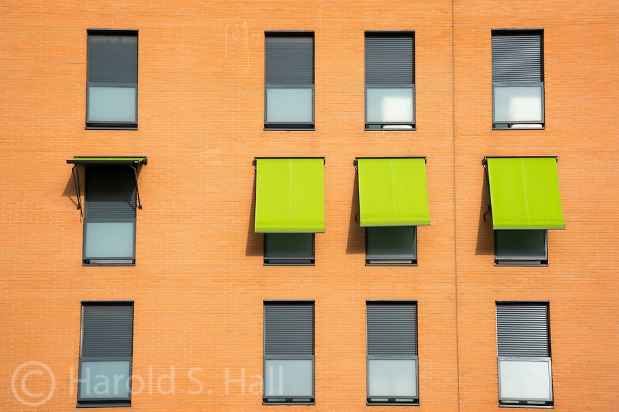 A design of brick and colorful window awnings in Madrid, Spain