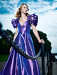 Artistic fashion portrait of a young beautiful woman in a beautiful long evening gown standing at a pier Image © MaximImages, License at https://www.maximimages.com