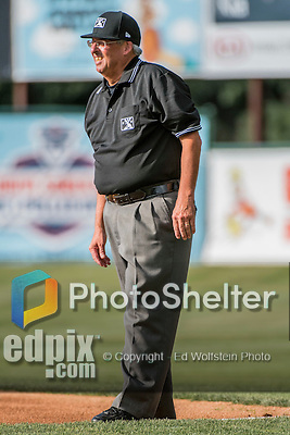 31 July 2016: Umpire Larry Riegert works the infield during a Single-A minor league baseball game between the Connecticut Tigers and the Vermont Lake Monsters at Centennial Field in Burlington, Vermont. Riegert, working as an MiLB substitute, is also the Vice President of the Northern Vermont Baseball Umpires Association. The Lake Monsters edged out the Tigers 4-3 in NY Penn League action.  Mandatory Credit: Ed Wolfstein Photo *** RAW (NEF) Image File Available ***