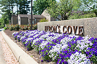 """""""Welcome home!"""" Housing development entrance sign in full spring bloom. Your real estate photos should create a homey, welcoming impression, and sometimes a feature like this entrance sign completes the look. By Art Harman."""