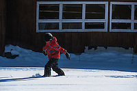 Shane from Gusty Michael School skis around Stony River, Alaska during a Skiku visit to the remote village. Skiku is a non-profit organization with the mission of creating a sustainable Nordic ski program in communities throughout Alaska. Volunteer coaches travel to villages each spring to instruct youngsters and distribute donated equipment with the goal of establishing ski programs at rural schools.  Photo by James R. Evans