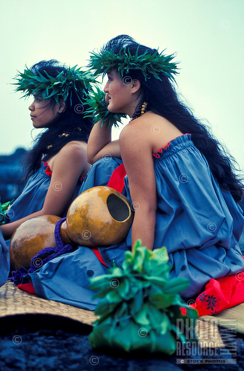 Hula dancers with ipu and ti leaf hookupu at a Hawaiian ceremony, Kilauea Volcano, Big Island of  Hawaii
