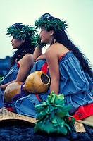 Hula dancers with ipu and ti leaf hookupu at a Hawaiian ceremony, Kilauea Volcano, Big Island of  Hawaii