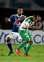 BOGOTA - COLOMBIA - 18 – 02 - 2018: Cesar Carrillo (Izq.) jugador de Millonarios salta a cabecear el balón con Macnelly Torres (Der.) jugador de Atletico Nacional, durante partido de la fecha 4 entre Millonarios y Atletico Nacional, por la Liga Aguila I 2018, jugado en el estadio Nemesio Camacho El Campin de la ciudad de Bogota. / Cesar Carrillo (L) player of Millonarios jump to the head the ball the ball with Macnelly Torres (L) player of Atletico Nacional, during a match of the 4th date between Millonarios and Atletico Nacional,  for the Liga Aguila I 2018 played at the Nemesio Camacho El Campin Stadium in Bogota city, Photo: VizzorImage / Luis Ramirez / Staff.