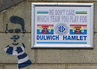 A sign on the wall of the Main Stand which reads, We don't care which team you play for during Dulwich Hamlet vs Brentford B, Friendly Match Football at Champion Hill Stadium on 31st July 2021