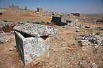An open tomb stands among the ruins of a dead city at Serjilla one of a series of ghost towns that lie scattered between Aleppo and Hama and were abandoned for unknown reasons