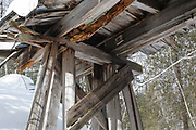 Built in the early 1900s, Trestle No. 16 crosses Black Brook along the old East Branch & Lincoln Railroad (1893-1948) in the Pemigewasset Wilderness of Lincoln, New Hampshire. This photo shows the underside of the trestle in February 2011.
