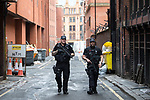 © Joel Goodman - 07973 332324 . 28/05/2017 . Manchester , UK . Armed police patrol the side streets in Manchester City Centre . The Great Manchester Run 2017 . Security is still heightened in Manchester following a murderous bomb attack at an Ariana Grande gig at Manchester Arena on Monday 22nd May . Photo credit : Joel Goodman
