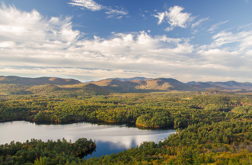Squam Lake shimmers in front of Mt. Isreal with the Sandwich Range beyond.