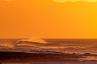 Waves and surf off North Shore Oahu during sunset