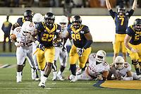 BERKELEY, CA - September 17, 2016: Running back (23) Vic Enwere breaks through for a long run late in the fourth quarter against Texas at Cal Memorial Stadium.