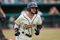 Francisco Acuna (7) of the Greensboro Grasshoppers hustles down the first base line against the Rome Braves at First National Bank Field on May 16, 2021 in Greensboro, North Carolina. (Brian Westerholt/Four Seam Images)