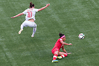 June 21, 2015: Ramona BACHMANN of Switzerland and Desiree SCOTT of Canada compete for the ball during a round of 16 match between Canada and Switzerland at the FIFA Women's World Cup Canada 2015 at BC Place Stadium on 21 June 2015 in Vancouver, Canada. Canada won 1-0. Sydney Low/Asteriskimages.com