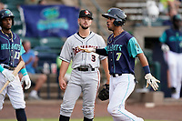 Second baseman Yordys Valdes (7) of the Lynchburg Hillcats reacts after scoring a run in a game against the Delmarva Shorebirds on Wednesday, August 11, 2021, at Bank of the James Stadium in Lynchburg, Virginia. (Tom Priddy/Four Seam Images)