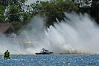 """Frame 3: Kevin Kreitzer, A-64 """"Blue Devil"""" hooks in turn 2 and blows some decking off the boat. (2.5 MOD class hydroplane(s)"""