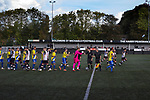 Boldmere St. Michaels 2 Worcester City 2, 16/10/2021. The Tom Brown Memorial Ground, Midland Football League Premier Division. The players exchanging greetings on the pitch before Boldmere St. Michaels play Worcester City (in yellow) in a Midland Football League Premier Division match at the Trevor Brown Memorial Ground in Sutton Coldfield. The home club were formed in 1883 and have played in local and regional football ever since, whilst the visitors were formerly one of the leading non-League clubs in England before a move from their St. George's Lane ground in 2013 started a downward spiral in their fortunes. Worcester City won this match 2-0, with a double from Aaron Roberts, despite playing for an hour with 10 men, watched by a crowd of 169 spectators, mainly away fans. Photo by Colin McPherson.