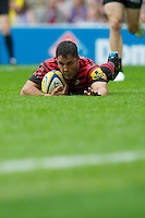 Brad Barritt of Saracens dives over to score a try during the Aviva Premiership match between Saracens and London Irish at Twickenham on Saturday 1st September 2012 (Photo by Rob Munro)