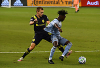 KANSAS CITY, KS - OCTOBER 11: #12 Alistair Johnston of Nashville SC fights for the ball with #12 Gerso Fernandes of Sporting Kansas City during a game between Nashville SC and Sporting Kansas City at Children's Mercy Park on October 11, 2020 in Kansas City, Kansas.