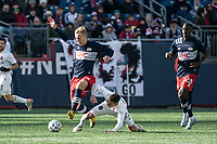 FOXBOROUGH, MA - MARCH 7: Adam Buksa #9 of New England Revolution tackled by Alvaro Medran #10 of Chicago Fire during a game between Chicago Fire and New England Revolution at Gillette Stadium on March 7, 2020 in Foxborough, Massachusetts.