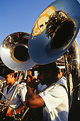Arraial d'Ajuda, Porto Seguro, Bahia State, Brazil; Roman Catholic religious procession; tubas in brass band. Church refelcted in the tuba.