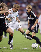 the Revolution's Taylor Twellman looks to get between D.C. United's Bryan Namoff and Brian Carroll. DC United defeated the New England Revolution 4 to 3 in a shoot out after overtime ended in a 3 all tie during the MLS Eastern Conference Championship at RFK Stadium, Washington, D.C., on Saturday, November 6, 2004..