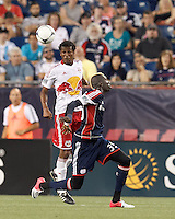 New York Red Bulls defender Roy Miller (7) heads the ball. New England Revolution midfielder Saer Sene (39). In a Major League Soccer (MLS) match, New England Revolution defeated New York Red Bulls, 2-0, at Gillette Stadium on July 8, 2012.