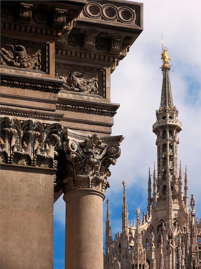 Column detail of Galleria Vittorio Emanuele II with the Duomo spires background, Milan, Ital
