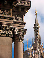Column detail of Galleria Vittorio Emanuele II with the Duomo spires background, Milan, Ital